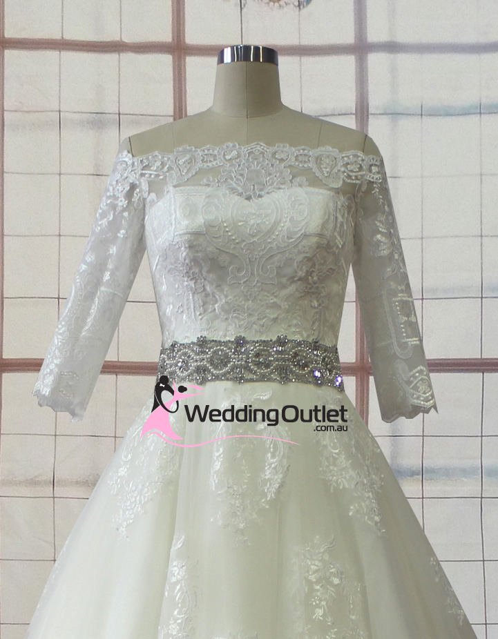 Jacinda lace long sleeved wedding gown with belt